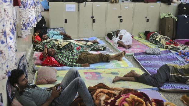 Workers rest in a school turned into a shelter in Salalah, Oman (Kamran Jebreili/AP)