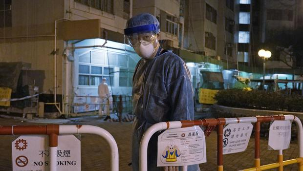 More than 1,000 health care workers are among those confirmed to have the virus (Kin Cheung/AP)