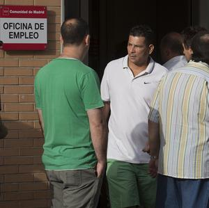Spain's Labour Ministry said the number of people registered as jobless fell by 64,866 last month (AP)