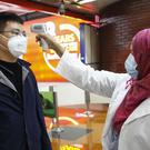 A passenger from Beijing is screened as part of measures to prevent coronavirus infection at Hazrat Shahjalal International airport in Dhaka, Bangladesh (AP/Al-emrun Garjon)