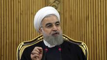 Iranian president Hassan Rouhani said Saudi Arabia 'cannot cover its crime' by severing ties with the Islamic Republic (AP)