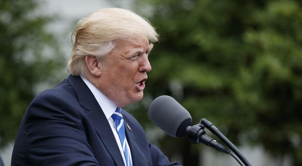 President Donald Trump claimed China was playing unfairly over its currency. (AP/Evan Vucci)