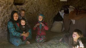 Marzia and her family in their cave home in Bamiyan, Afghanistan (AP)