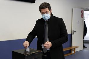 Right-wing populist presidential candidate Andre Ventura casts his ballot at a polling station in Lisbon (Armando Franca/AP)