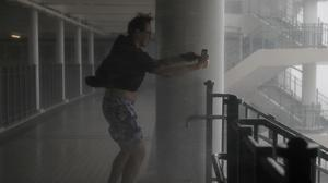 A man takes pictures against strong winds from Typhoon Mangkhut on the waterfront of Victoria Harbour Hong Kong (Vincent Yu/AP)