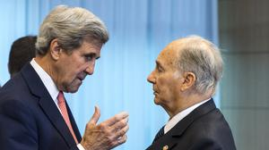 US secretary of state John Kerry, left, talks with Prince Aga Khan during a Conference on Afghanistan in Brussels (AP)