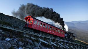 A steam engine pushes a passenger car up the Cog Railway on Mount Washington (Robert F Bukaty/AP)