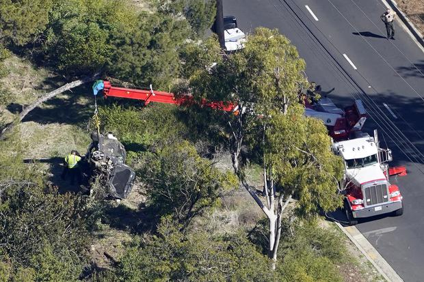 Woods suffered a serious leg injury when the SUV he was driving came off a Los Angeles County road (Mark J Terrill/AP)