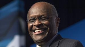 Herman Cain has died aged 74 (AP/Molly Riley, File)