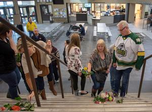 Humboldt mayor Rob Muench, in a Broncos top, with other mourners at Elgar Petersen Arena, home of the Humboldt Broncos (Liam Richards/The Canadian Press via AP)