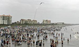 Crowds gather in the surf and on the beach in Cocoa Beach, Florida, in 2011 to watch the launch of the space shuttle Atlantis (Dave Martin/AP)