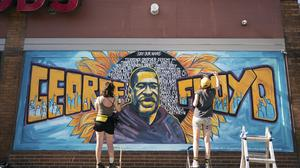 Artists complete a mural of George Floyd (Mark Vancleave/Star Tribune via AP)