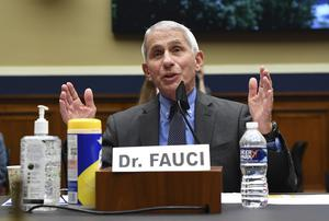 Dr Fauci told the House committee caution was needed to arrest concerning surges in Covid-19 cases across the US (Kevin Dietsch/Pool via AP)