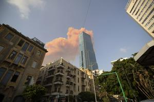 A cloud from a massive explosion is seen in in Beirut (Hassan Ammar/AP)