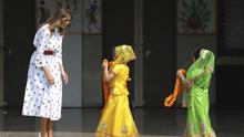 US first lady Melania Trump waits to be garlanded by two children at Sarvodaya Co-Educational Senior Secondary School in New Delhi (AP)