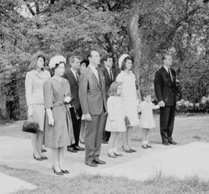 President Kennedy's children Caroline and John, whose hand is held by the Duke of Edinburgh (far right) before the memorial to their assassinated father at Runnymede (PA)