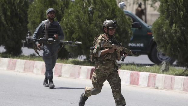 Security personnel arrive at the site of an attack in the Afghan Interior Ministry in Kabul (AP)