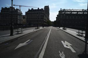 The deserted bridge going to Notre Dame cathedral (AP/Thibault Camus)