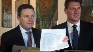 Australian Christian Lobby managing director Lyle Shelton, left, presents Australian Conservatives party leader Cory Bernardi with a 55,000-signature petition demanding a public vote on whether Australia should allow gay marriage (AP)