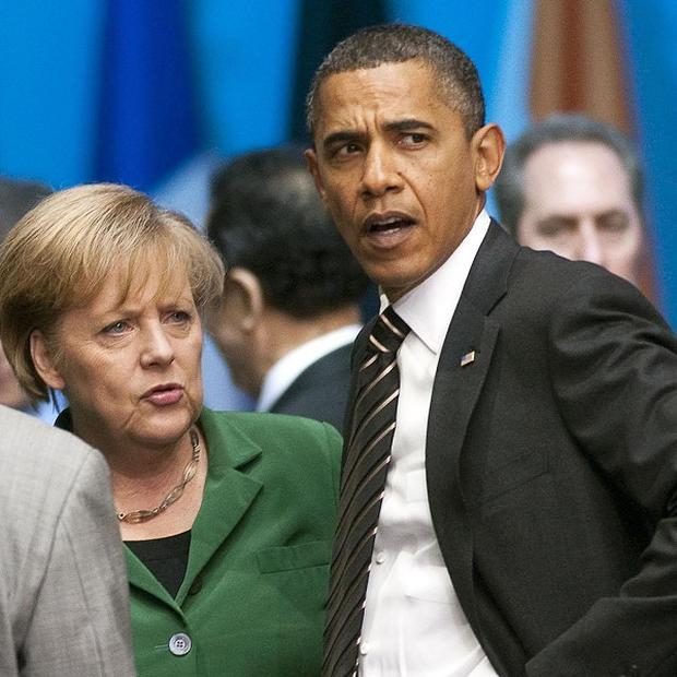 US president Barack Obama has moved to repair relations with Germany's chancellor Angela Merkel over America's spying programme
