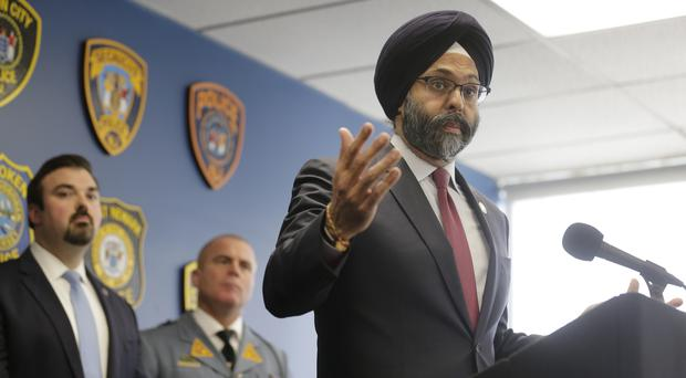 New Jersey Attorney General Gurbir Grewal speaks during a news conference in Jersey City (Seth Wenig/AP)