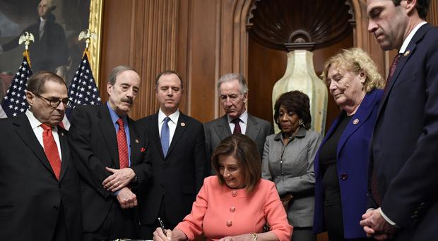 House Speaker Nancy Pelosi. signs the resolution to transmit the two articles of impeachment against President Donald Trump (Susan Walsh/AP)