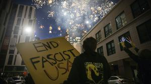 Protesters light fireworks in Oakland, California (Christian Monterrosa/AP)
