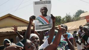 Gambians celebrate the victory of opposition coalition candidate Adama Barrow against long-time president Yahya Jammeh on the streets of Serrekunda (AP)