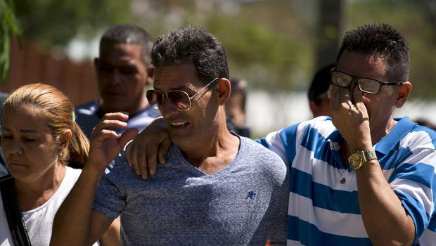Grieving relatives of passengers who perished in Cuba's worst aviation disaster (Ramon Espinosa/AP)