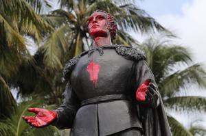 A statue of Christopher Columbus was vandalised at Bayfront Park in Miami (AP)