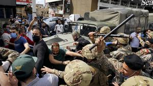 Anti-government protesters scuffle with Lebanese soldiers (AP Photo/Bilal Hussein)