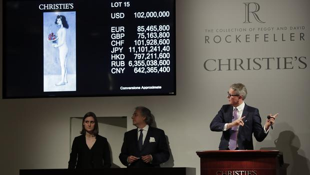 "Global president of Christie's Jussi Pylkkanen guides the bidding for Pablo Picasso's ""Fillette a la corbeille fleurie"" which sold for $102 million (Julie Jacobson/AP)"