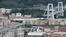 Cars blocked on the Morandi highway bridge after a section of it collapsed (Antonio Calanni/AP)