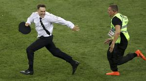 Pyotr Verzilov, left, attracted worldwide attention in 2018 when he ran onto the field during the World Cup final in Moscow (Thanassis Stavrakis/AP)