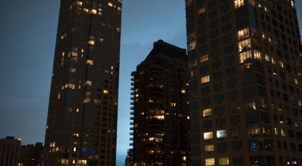 The night sky of New York was lit up in blue following a transformer explosion (AP Photo/Craig Ruttle)