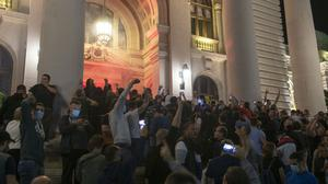 Protesters gather in front of the Serbian parliament in Belgrade (Marko Drobnjakovic/AP)