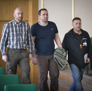 Vacheslav Ponomarev, the self-proclaimed mayor of Slovyansk, right, enters a hall with a group of foreign military observers, including Col Axel Schneider, far left (AP)