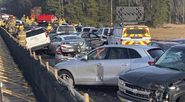 Emergency personnel work the scene of a multi-vehicle pileup on Interstate 64 in York County, Virginia (Virginia State Police/AP)