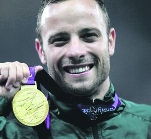 File photo dated 08/09/12 of Oscar Pistorius after winning his gold medal at the Paralympic games in 2012. A woman has been found shot dead at his South African home.  PRESS ASSOCIATION Photo. Issue date: Saturday September 8, 2012. See PA story POLICE Pistorius. Photo credit should read: David Davies/PA Wire