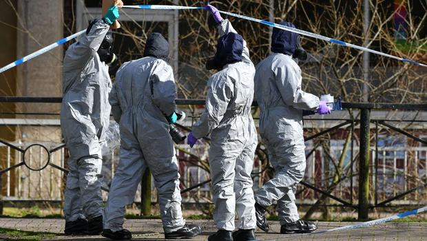 Police in protective suits in Salisbury, where Sergei Skripal and his daughter Yulia were found critically ill (Ben Birchall/PA)