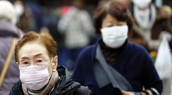 China has reported 17 more patients have been infected with a new form of coronavirus that has killed two people (Eugene Hoshiko/AP)