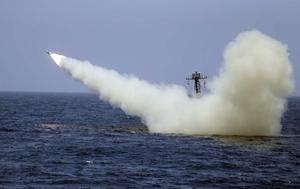 A warship launches a missile during an Iranian naval exercise (Iranian navy/AP)