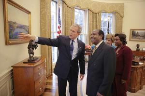 Paul Rusesabagina and his wife Tatiana meet George and Laura Bush at the Oval Office in 2005 (Eric Draper/The White House/AP)