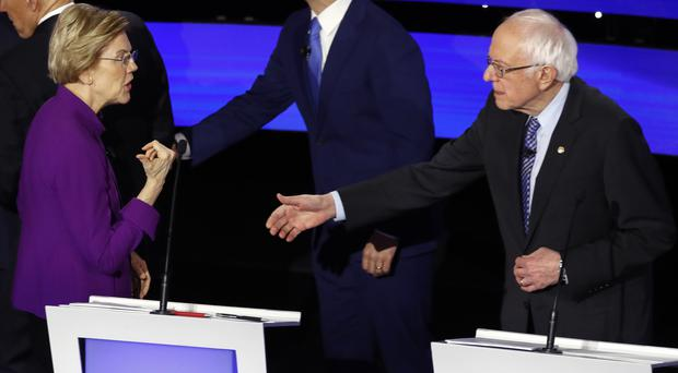 Democratic presidential candidate Elizabeth Warren appears to refuse Bernie Sanders' outstretched hand at the conclusion of the final Democratic debate (Patrick Semansky/AP)