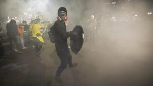 Tear gas fills the air outside the federal courthouse in Portland (Marcio Jose Sanchez/AP)