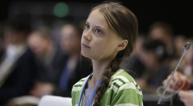 Swedish climate activist Greta Thunberg listens to speeches at the summit (Paul White/AP)