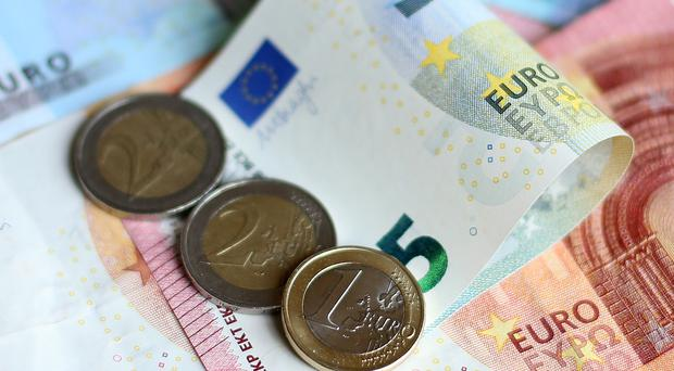 Euro notes and coins (Niall Carson/PA)