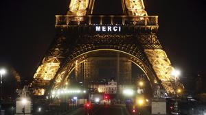 The Eiffel Tower emblazoned with the word 'Merci' (AP/Thibault Camus)
