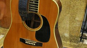 The acoustic guitar played by Elvis Presley during the final tour before his death in 1977 pictured on display at the National Music Museum in Vermillion (AP)