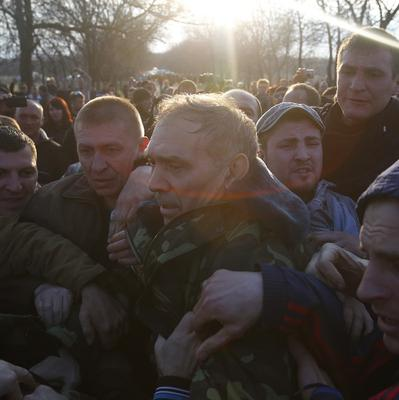 Ukrainian General Vasyl Krutov is attacked by pro-Russian activists outside Kramatorsk airport (AP)